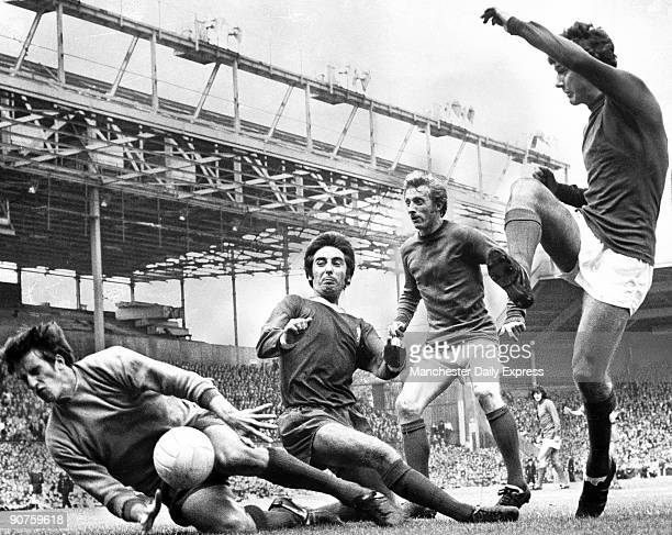 Manchester United's Denis Law looks on as team mate Brian Kidd almost scores, Liverpool's Roy Evans attempts to block.