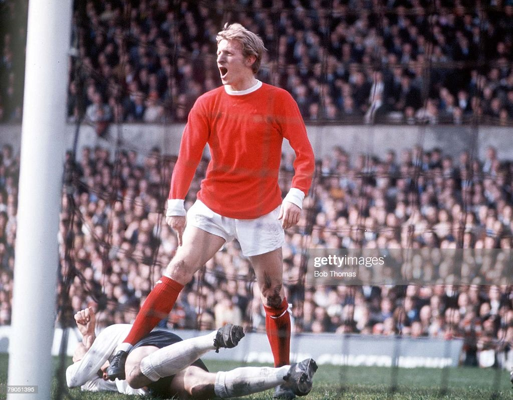 SPORT. FOOTBALL. Manchester United's Denis Law voices his opinion during a League match. : News Photo