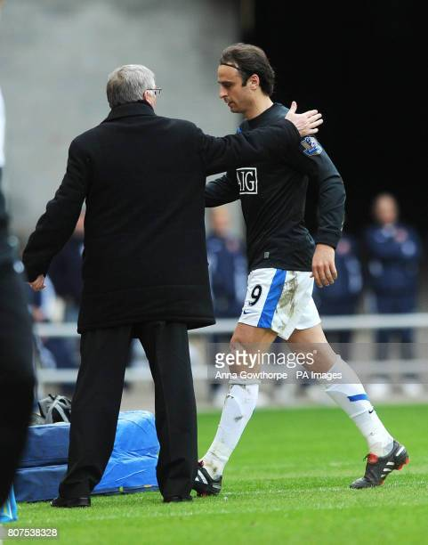 Manchester United's Dimitar Berbatov is substituted by Sir Alex Ferguson during the Barclays Premier League Match at the Stadium of Light Sunderland