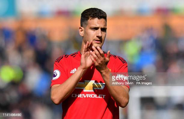 Manchester United's Diogo Dalot applauds the fans after the final whistle of the Premier League match at the John Smith's Stadium Huddersfield