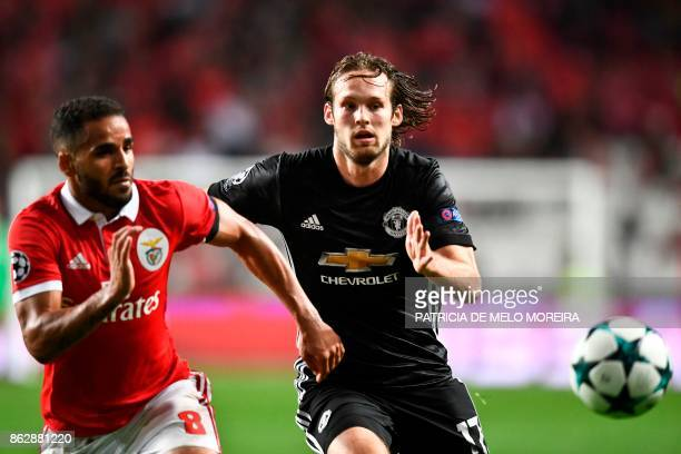 Manchester United's Ducth defender Daley Blind vies with Benfica's Brazilian defender Douglas dos Santos during the UEFA Champions League group A...