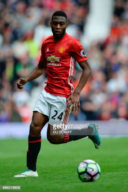 Manchester United's Dutch defender Timothy FosuMensah controls the ball during the English Premier League football match between Manchester United...
