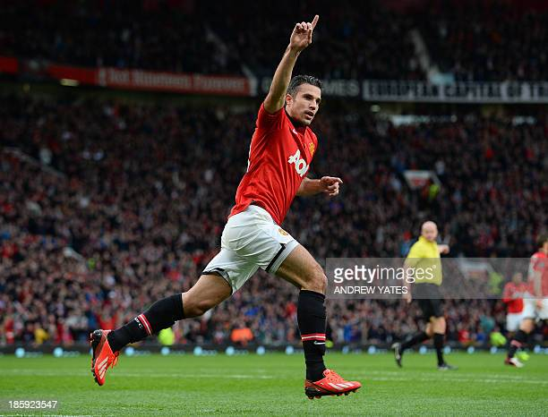 Manchester United's Dutch forward Robin van Persie celebrates after scoring his team's first goal during the English Premier League football match...
