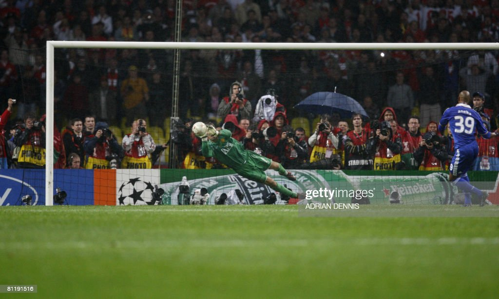 Manchester United's Dutch goalkeeper Edwin van der Sar (L) saves a penalty from Chelsea's Nicolas Anelka to win the final of the UEFA Champions League football match against Manchester United at the Luzhniki stadium in Moscow on May 21, 2008. The match remained at a 1-1 draw and Manchester won on penalties after extra time. AFP PHOTO / Adrian Dennis