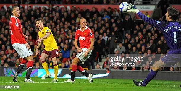 Manchester United's Dutch goalkeeper Edwin van der Sar saves at attempt from Arsenal's French defender Laurent Koscielny during the FA Cup...