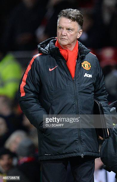 Manchester United's Dutch manager Louis van Gaal leaves the pitch at the end of the FA Cup quarterfinal football match between Manchester United and...