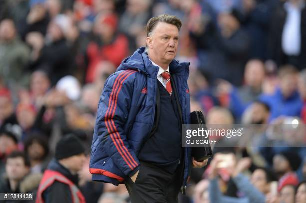 Manchester United's Dutch manager Louis van Gaal leaves the pitch at the end of the English Premier League football match between Manchester United...
