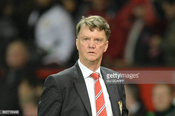 Manchester United's Dutch manager Louis van Gaal leaves the pitch after the final whistle of the English Premier League football match between...