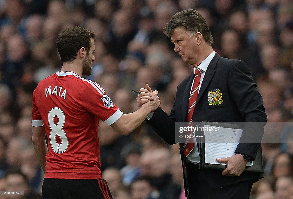 Manchester United's Dutch Manager Louis Van Gaal Shakes