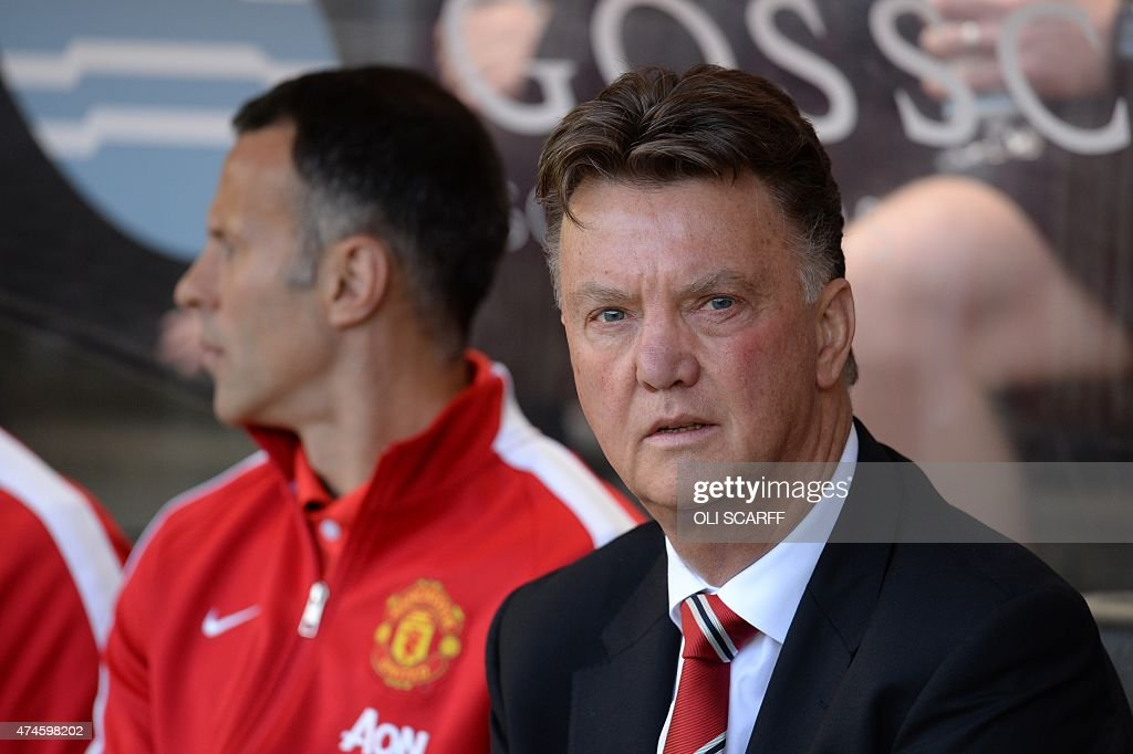 Manchester United's Dutch Manager Louis Van Gaal Sits With