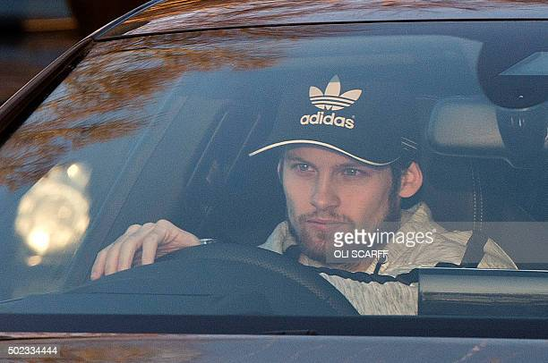 Manchester United's Dutch midfielder Daley Blind arrives to attend a team training session at Manchester United's Carrington training complex in...