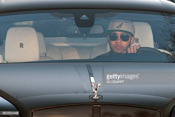 Manchester United's Dutch striker Memphis Depay arrives to attend a team training session at Manchester United's Carrington training complex in...