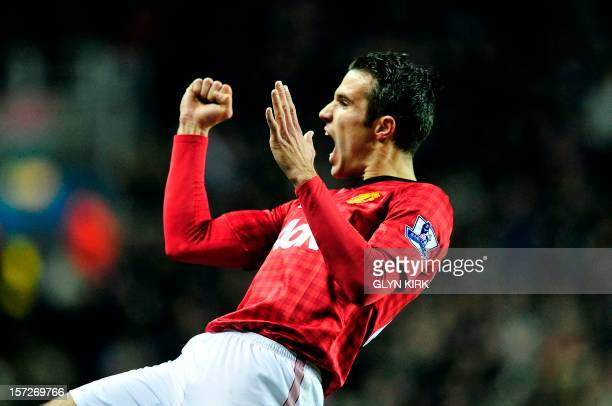 Manchester United's Dutch striker Robin Van Persie celebrates scoring their fourth goal during the English Premier League football match between...