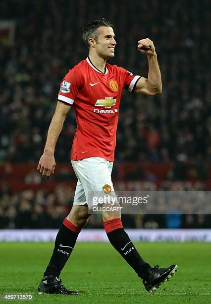 Manchester United's Dutch striker Robin van Persie celebrates scoring his team's third goal during the English Premier League football match between...