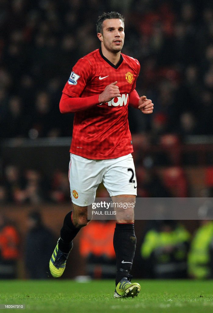 """Manchester United's Dutch striker Robin van Persie comes on as a substitute during the English FA Cup fifth round football match between Manchester United and Reading at Old Trafford in Manchester, north west England, on February 18, 2013. USE. No use with unauthorized audio, video, data, fixture lists, club/league logos or """"live"""" services. Online in-match use limited to 45 images, no video emulation. No use in betting, games or single club/league/player publications."""