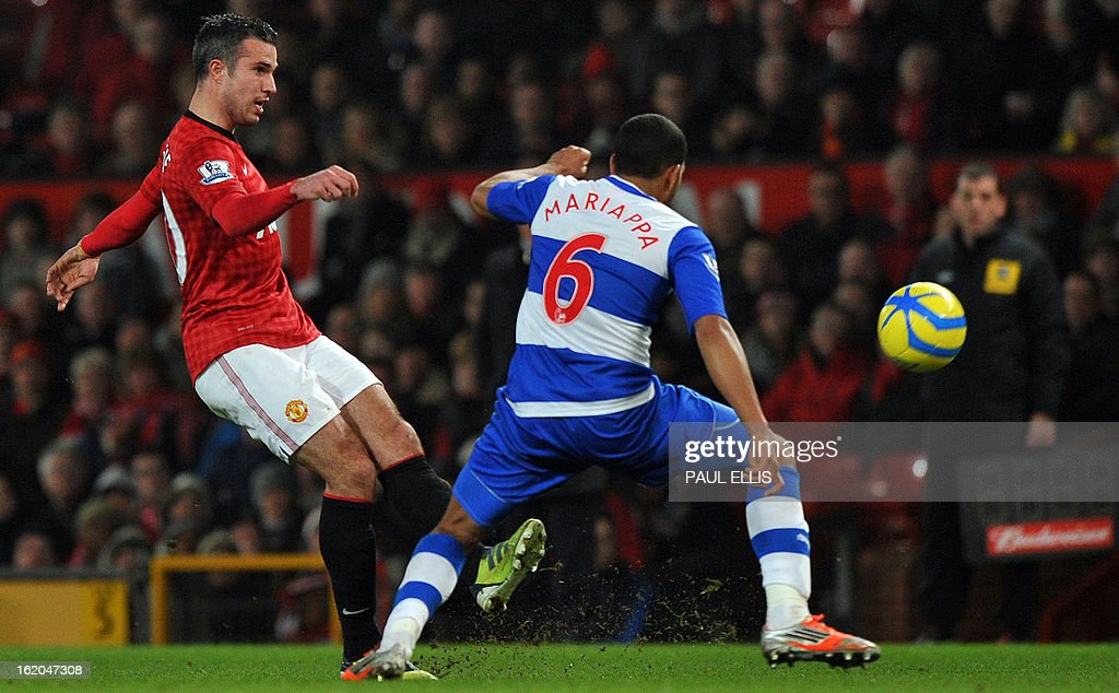 """Manchester United's Dutch striker Robin van Persie (L) shoots past Reading's Jamaican defender Adrian Mariappa (R) during the English FA Cup fifth round football match between Manchester United and Reading at Old Trafford in Manchester, north west England, on February 18, 2013. USE. No use with unauthorized audio, video, data, fixture lists, club/league logos or """"live"""" services. Online in-match use limited to 45 images, no video emulation. No use in betting, games or single club/league/player publications."""