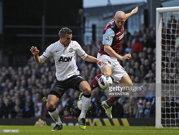 Manchester United's Dutch striker Robin van Persie vies with West Ham United's Welsh defender James Collins during the English Premier League...