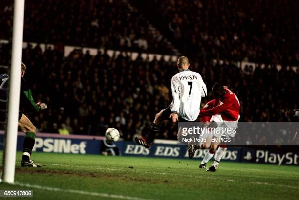 Manchester United's Dwight Yorke scores the third goal against Derby