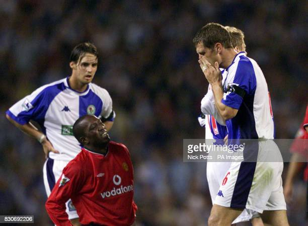 LEAGUE Manchester United's Dwight Yorke wince's in pain after a tackle that saw Blackburn Rovers' Craig Short sent off for a second yellow card...