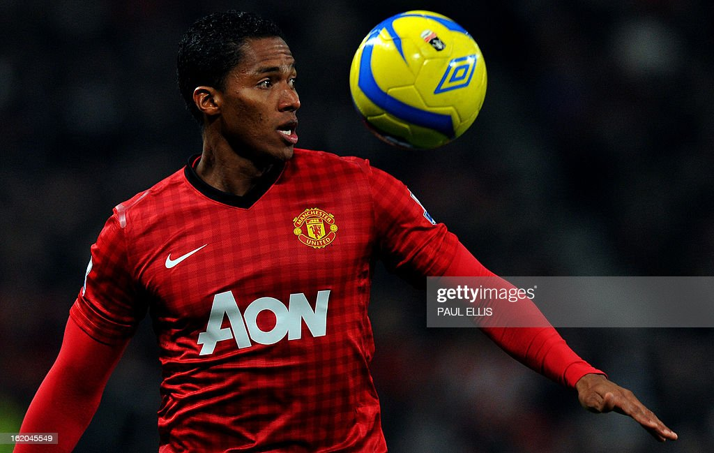 """Manchester United's Ecuador midfielder Antonio Valencia controls the ball during the English FA Cup fifth round football match between Manchester United and Reading at Old Trafford in Manchester, north west England, on February 18, 2013. USE. No use with unauthorized audio, video, data, fixture lists, club/league logos or """"live"""" services. Online in-match use limited to 45 images, no video emulation. No use in betting, games or single club/league/player publications."""