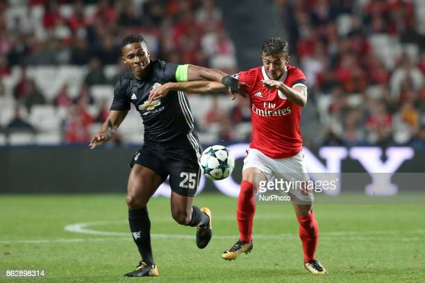 Manchester United's Ecuadorian defender Antonio Valencia fights for the ball with Benfica's Portuguese midfielder Diogo Goncalves during the UEFA...