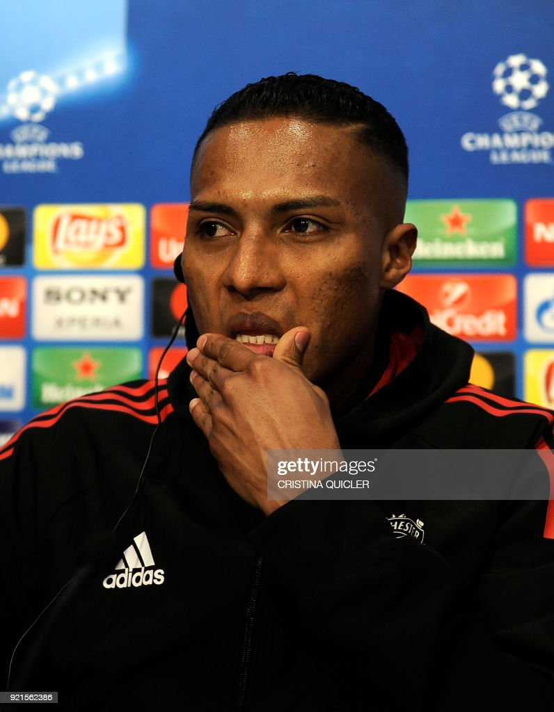 Manchester United's Ecuadorian midfielder Antonio Valencia (R) attends a press conference at the Ramon Sanchez Pizjuan stadium in Sevilla on the eve of the UEFA Champions League football match between Sevilla and Manchester United on February 20, 2018. / AFP PHOTO / Cristina Quicler