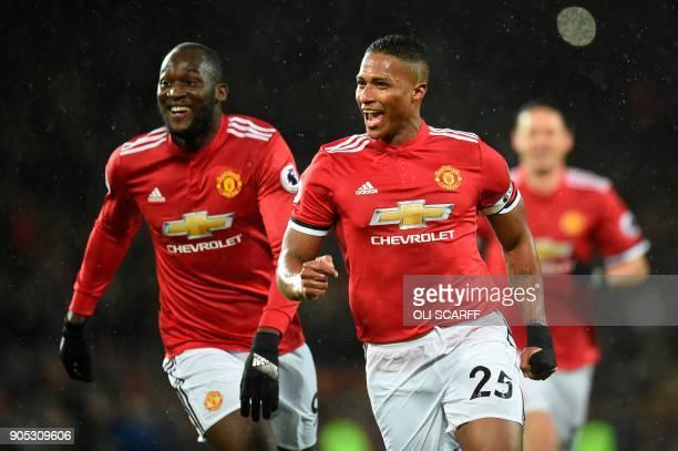 Manchester United's Ecuadorian midfielder Antonio Valencia celebrates scoring the opening goal with Manchester United's Belgian striker Romelu Lukaku...