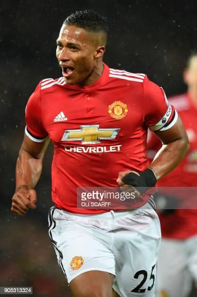 Manchester United's Ecuadorian midfielder Antonio Valencia celebrates scoring the opening goal during the English Premier League football match...