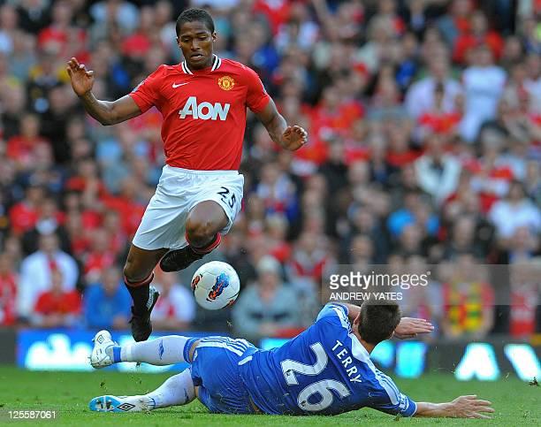 Manchester United's Ecuadorian midfielder Antonio Valencia vies with Chelsea's English defender John Terry during the English Premier League football...