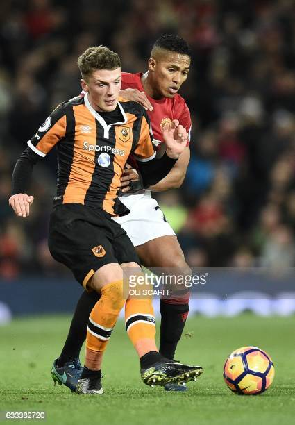 Manchester United's Ecuadorian midfielder Antonio Valencia vies with Hull City's English defender Josh Tymon during the English Premier League...