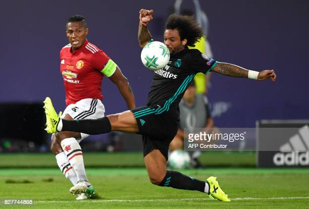 Manchester United's Ecuadorian midfielder Antonio Valencia vies with Real Madrid's Brazilian defender Marcelo during the UEFA Super Cup football...