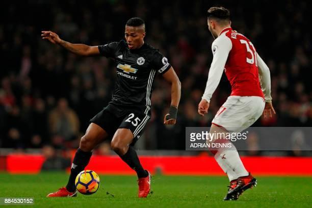 Manchester United's Ecuadorian midfielder Antonio Valencia vies with Arsenal's Germanborn Bosnian defender Sead Kolasinac during the English Premier...