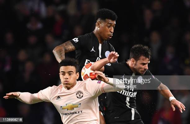 TOPSHOT Manchester United's Engish forward Mason Greenwood fights for the ball with Paris SaintGermain's French defender Presnel Kimpembe and Paris...