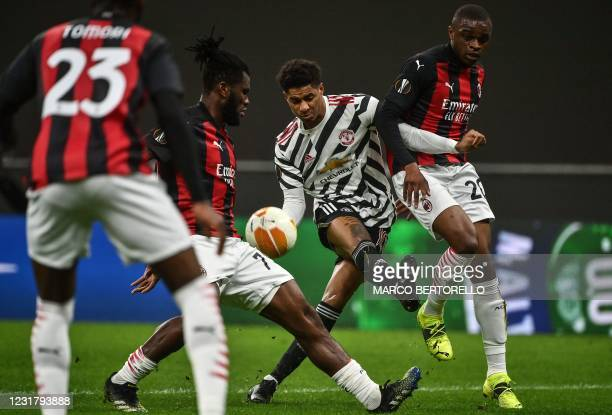 Manchester United's England's forward Marcus Rashford challenges AC Milan's Ivorian midfielder Franck Kessie and AC Milan's French defender Pierre...