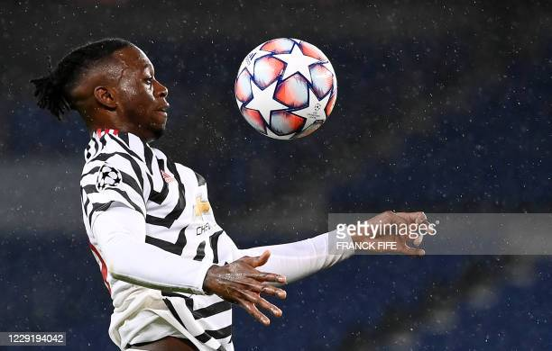 Manchester United's English defender Aaron Wan-Bissaka controls the ball during the UEFA Champions League Group H first-leg football match between...
