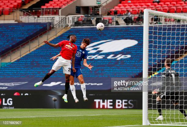 Manchester United's English defender Aaron WanBissaka jumps with Chelsea's Spanish defender Marcos Alonso during the English FA Cup semifinal...
