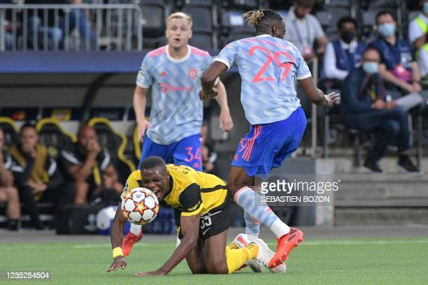 Manchester United's English defender Aaron Wan-Bissaka tackles Young Boys' Luxembourgish midfielder Christopher Martins during the UEFA Champions...