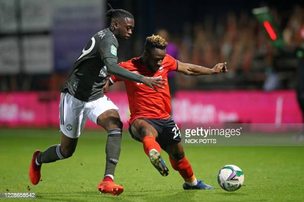 Manchester United's English defender Aaron Wan-Bissaka vies for the ball against Luton Town's Congolese midfielder Kazenga LuaLua during the English...