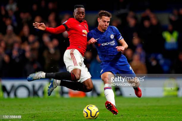 Manchester United's English defender Aaron WanBissaka vies with Chelsea's Spanish defender Cesar Azpilicueta during the English Premier League...