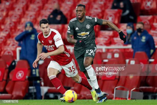 Manchester United's English defender Aaron Wan-Bissaka vies with Arsenal's Brazilian striker Gabriel Martinelli during the English Premier League...