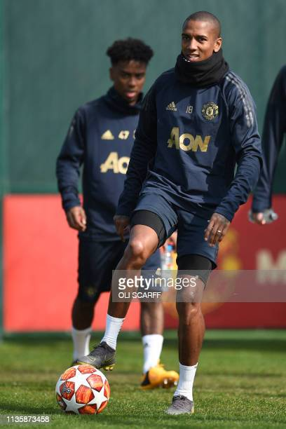 Manchester United's English defender Ashley Young attends a training session at the Carrington training ground in greater Manchester north west...