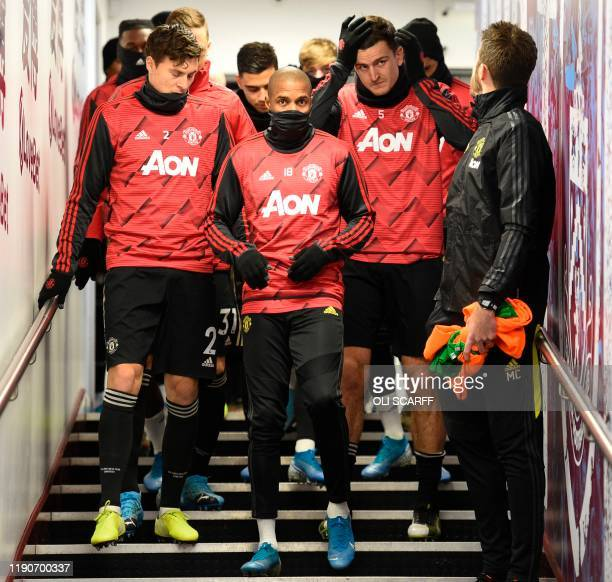 Manchester United's English defender Ashley Young leads his players out of the players tunnel onto the pitch to warm up for the English Premier...