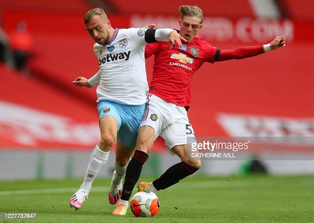 Manchester United's English defender Brandon Williams challenges West Ham United's English striker Jarrod Bowen during the English Premier League...
