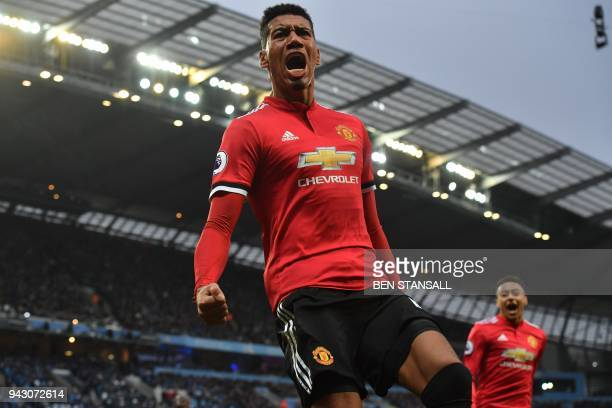 Manchester United's English defender Chris Smalling celebrates scoring their third goal during the English Premier League football match between...