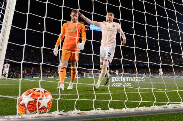 Manchester United's English defender Chris Smalling conforts Manchester United's Spanish goalkeeper David De Gea after concedeing the opening goal...