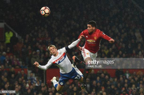 Manchester United's English defender Chris Smalling heads the ball in to score their second goal during the English FA Cup fourth round football...