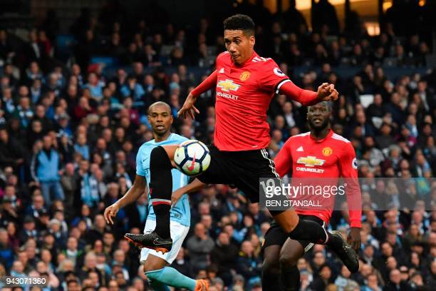 TOPSHOT Manchester United's English defender Chris Smalling scores their third goal during the English Premier League football match between...