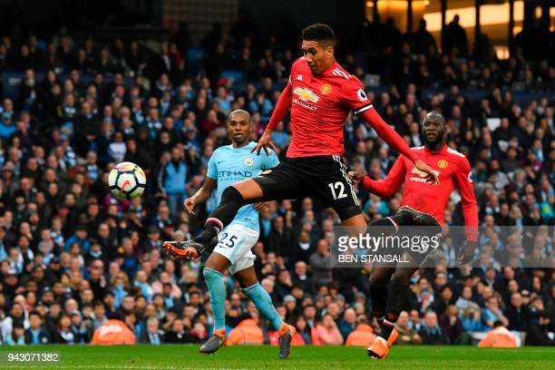 Manchester United's English defender Chris Smalling scores their third goal during the English Premier League football match between Manchester City...