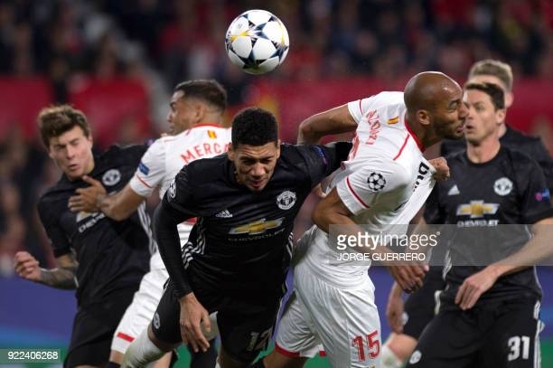 Manchester United's English defender Chris Smalling vies with Sevilla's French midfielder Steven N'Zonzi during the UEFA Champions League round of 16...
