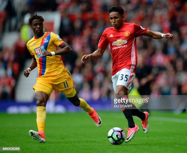 Manchester United's English defender Demetri Mitchell battles with Crystal Palace's Ivorian striker Wilfried Zaha during the English Premier League...
